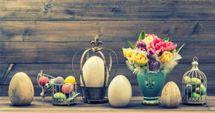 Retro style still life with tulip flowers and easter eggs. Vinta Royalty Free Stock Photos