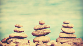 Retro style stones on a beach, spa concept background Royalty Free Stock Photo