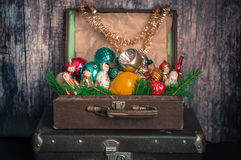 Retro Style Suitcases with Christmas Tree Decorations. Retro Style Leather Suitcases with Old Fashioned Christmas Tree Decorations Royalty Free Stock Photos