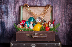 Retro Style Suitcases with Christmas Tree Decorations. Retro Style Leather Suitcases with Old Fashioned Christmas Tree Decorations Stock Image