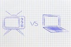 Retro style television vs laptop computer Stock Photos