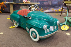 Retro style toy car in a living room.  Royalty Free Stock Photo
