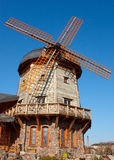 Retro style windmill. On clear blue sky background Stock Photo