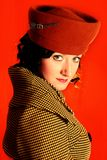 Retro-style woman. On the coat Stock Images