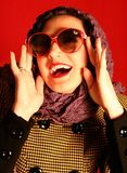 Retro-style woman. On red background Royalty Free Stock Photos