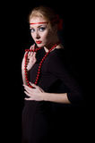 Retro style woman dress and red necklace Royalty Free Stock Images