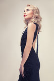 Retro style woman toned image on gray background Royalty Free Stock Photography