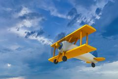Vintage wooden toy airplane flying on cloudy sky. Retro style wooden biplane toy, represented as flying on a cloudy sky background. Yellow wings, propeller in vector illustration