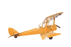 Retro style yellow biplane isolated on white background with cli Royalty Free Stock Photography