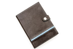 Retro styled brown leather notebook with blue stiching and strip Royalty Free Stock Photos