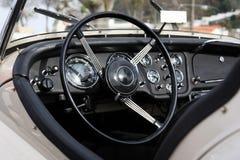 Retro styled classic car dashboard. Under sunlight Royalty Free Stock Photos