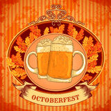 Retro styled emblem with glasses of beer, autumn leaves and the text Beer festival Oktoberfest on wooden background. Stock Photos