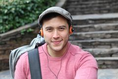 Retro styled ethnic male listening to music.  Stock Photo