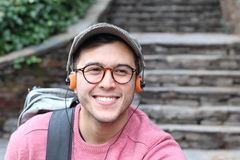 Retro styled ethnic male listening to music.  Stock Photos