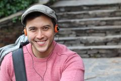 Retro styled ethnic male listening to music.  Royalty Free Stock Photography
