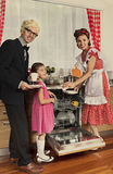 Retro styled family in a kitchen. Stock Photos