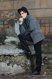 Retro styled fashion portrait of a handsome. Clothing and make-u Stock Photo