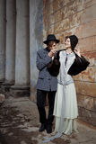 Retro styled fashion portrait of a young couple. Clothing and make-up in 1920s style royalty free stock photography