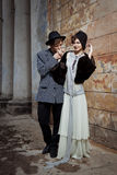 Retro styled fashion portrait of a young couple. Royalty Free Stock Photos