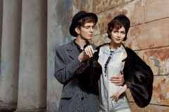 Retro styled fashion portrait of a young couple. Royalty Free Stock Image