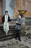 Retro styled fashion portrait of a young couple. Clothing and make-up in 1920s style stock photos