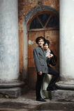 Retro styled fashion portrait of a young couple. Stock Photos