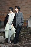 Retro styled fashion portrait of a young couple. Clothing and make-up in 1920's style royalty free stock photo