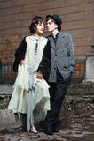 Retro styled fashion portrait of a young couple. Clothing and make-up in 1920's style royalty free stock images