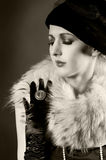 Retro styled fashion portrait of a young woman. In gloves. Clothing and make-up in vintage 1920s style royalty free stock photo
