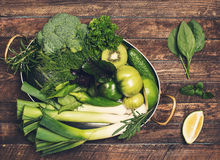 Retro styled food background. Raw detox green vegetable and herb Royalty Free Stock Image
