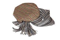 Retro-styled gentlemen`s tweed cap and scarf isolated Stock Photo