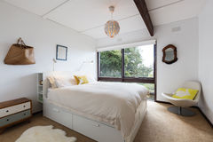 Retro styled guest bedroom in a 70s beach house. Shack stock images
