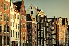 Retro styled image of ancient canal houses in Amsterdam Royalty Free Stock Photography