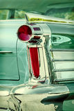 Retro styled image of the back of a green classic car Royalty Free Stock Photos