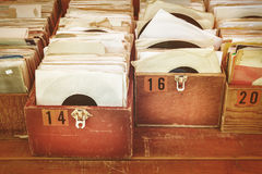 Retro styled image of boxes with vinyl turntable records Stock Image