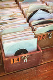 Retro styled image of boxes with vinyl turntable records Stock Photo