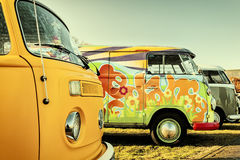 Retro styled image of colorful Volkswagen Transporter type 2 van Stock Photography