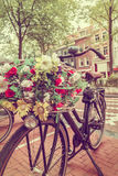 Retro styled image of a Dutch bicycle in Amsterdam Royalty Free Stock Photos