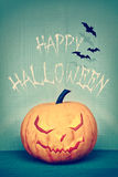 Retro styled image of a Halloween pumpkin royalty free stock image