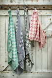 Retro styled image of hanging dish cloths Royalty Free Stock Photo