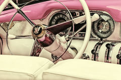 Retro styled image of the interior of a fifties Buick Century Co Royalty Free Stock Photography