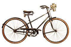 Retro styled image of a nineteenth century lady bicycle. With lantern isolated on a white background Royalty Free Stock Photos