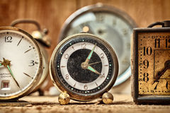 Retro styled image of old alarm clocks Stock Photography