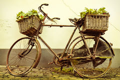Retro styled image of an old bicycle with baskets Royalty Free Stock Images