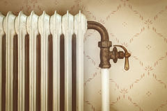 Retro styled image of an old central heating radiator Stock Photo