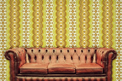 Retro styled image of an old chesterfield sofa Royalty Free Stock Photos