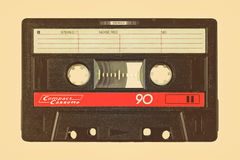 Retro styled image of an old compact cassette. With empty label Royalty Free Stock Images