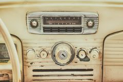 Retro styled image of an old car dashboard. Retro styled image of an old dashboard inside a classic car royalty free stock photo