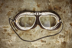 Retro styled image of old leather race goggles Stock Images