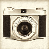 Retro styled image of an old photo camera Royalty Free Stock Images